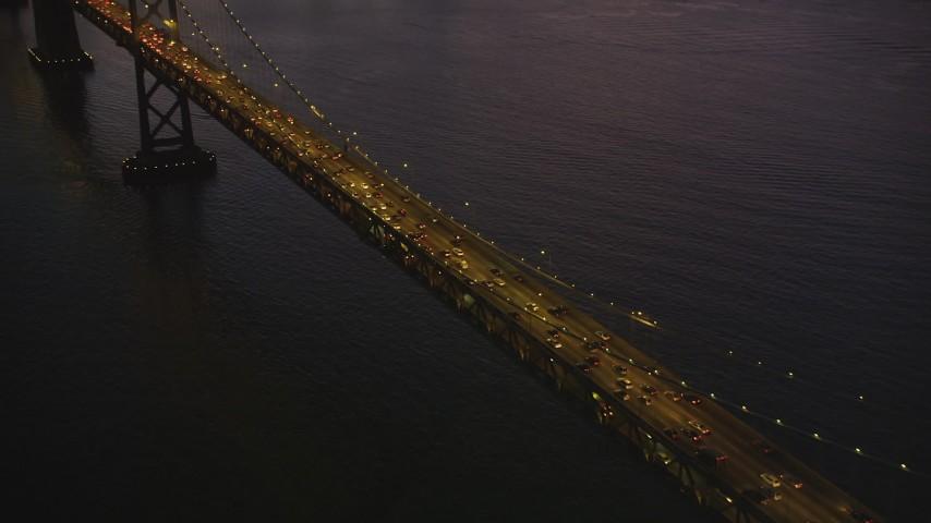 5K Aerial Video Bird's eye view of heavy traffic on the Bay Bridge, San Francisco, California, twilight Aerial Stock Footage | DCSF07_101