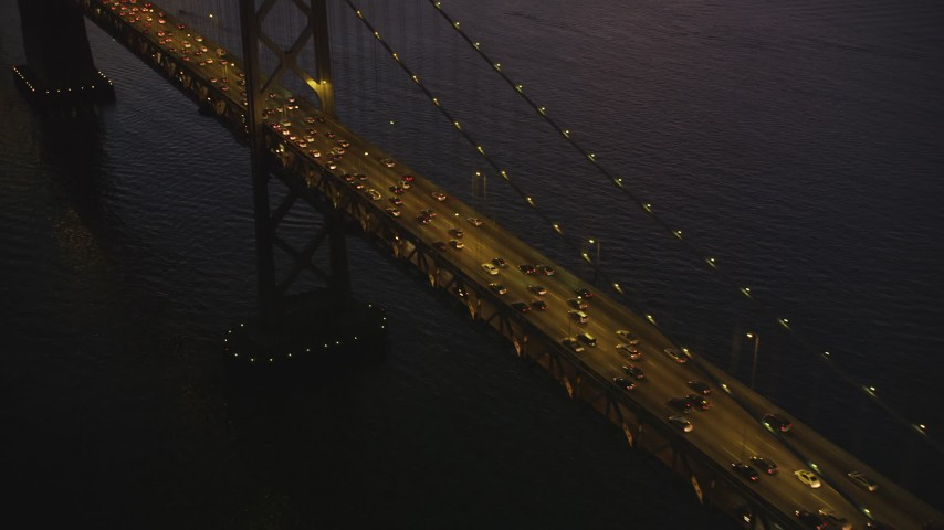 5K Aerial Video Tilt from Bay Bridge to reveal North Beach and Downtown San Francisco, California, twilight Aerial Stock Footage | DCSF07_102