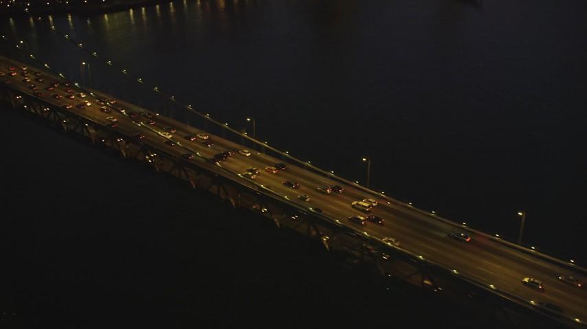 5K Aerial Video Flying by heavy traffic on the Bay Bridge, San Francisco, California, night Aerial Stock Footage | DCSF07_103