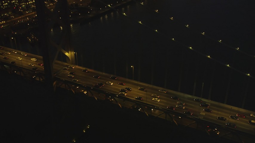 5K Aerial Video Tilt from heavy traffic on the Bay Bridge, reveal Downtown San Francisco, California, twilight Aerial Stock Footage | DCSF07_104