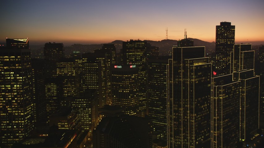 5K Aerial Video Flyby skyscrapers to reveal Market Street in Downtown San Francisco, California, twilight Aerial Stock Footage | DCSF07_107