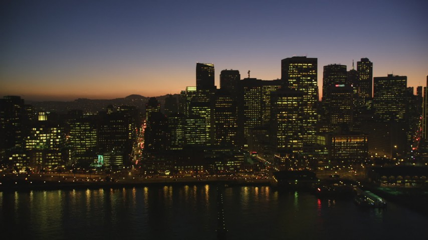 5K Aerial Video Flyby downtown skyline and reveal the Ferry Building, Downtown San Francisco, California, twilight Aerial Stock Footage | DCSF07_109
