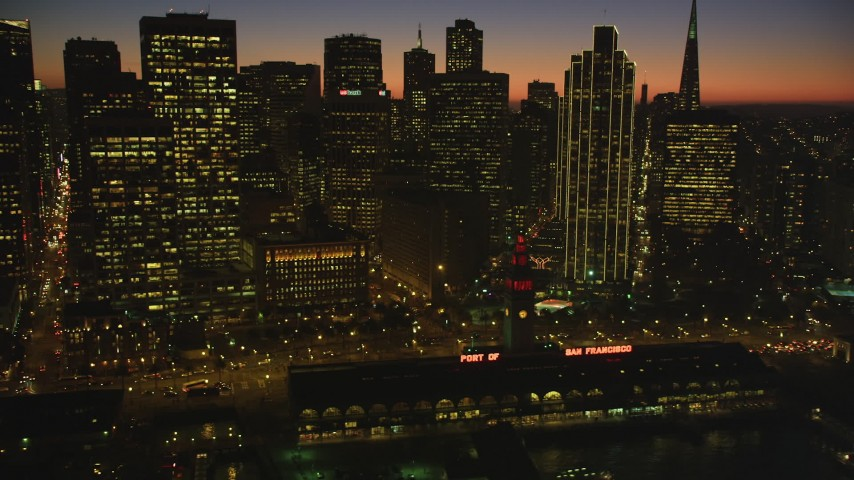 5K Aerial Video Flyby Ferry Building and towering skyline of Downtown San Francisco, California, twilight Aerial Stock Footage | DCSF07_112