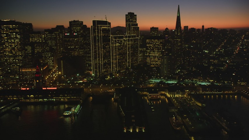 5K Aerial Video Passing by Downtown San Francisco and Transamerica Pyramid, California, twilight Aerial Stock Footage | DCSF07_113