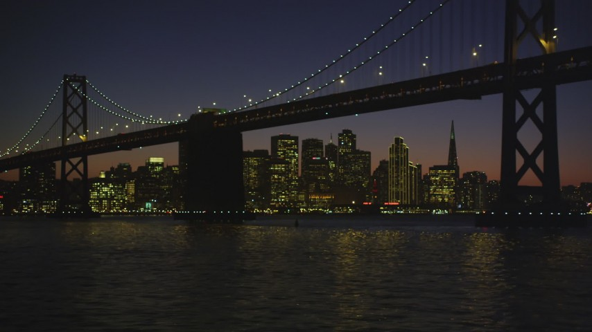 5K Aerial Video Bay Bridge in front of the Downtown San Francisco skyline, California, night Aerial Stock Footage | DCSF07_120