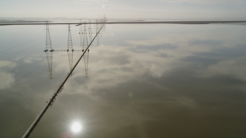 5K Aerial Video Fly over wetlands while following a row of power lines, Sunnyvale, California Aerial Stock Footage | DCSF08_011