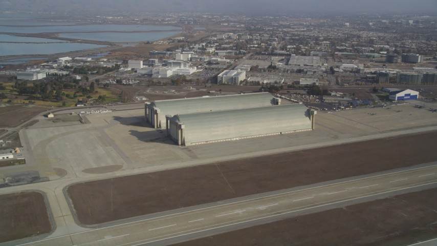 5K Aerial Video Tilt from a parked jet to reveal and approach Hangar Two and Three, Moffett Field, Mountain View, California Aerial Stock Footage | DCSF08_021