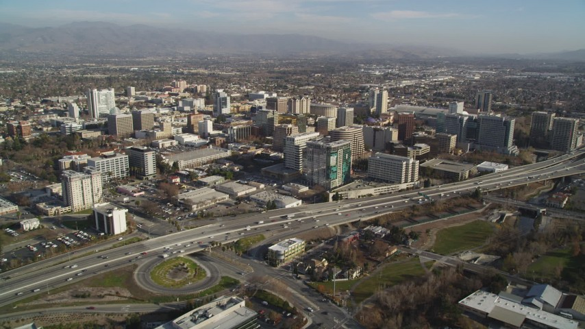 5K Aerial Video Tilt from Target rooftop to reveal and approach Highway 87 and Downtown San Jose high rises, California Aerial Stock Footage | DCSF09_001