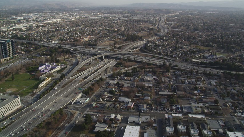 5K Aerial Video Flying by freeway interchange by Downtown San Jose, California Aerial Stock Footage | DCSF09_005