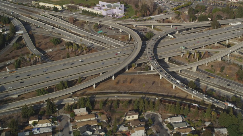 5K Aerial Video Flying over freeway interchange, tilt to reveal Downtown San Jose, California Aerial Stock Footage | DCSF09_007