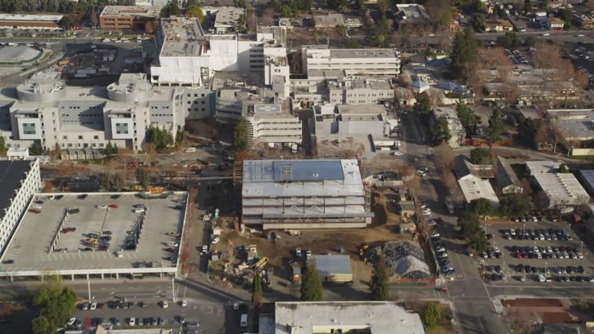 5K Aerial Video Reverse view of suburban neighborhoods, reveal Santa Clara Valley Medical Center, San Jose, California Aerial Stock Footage | DCSF09_010