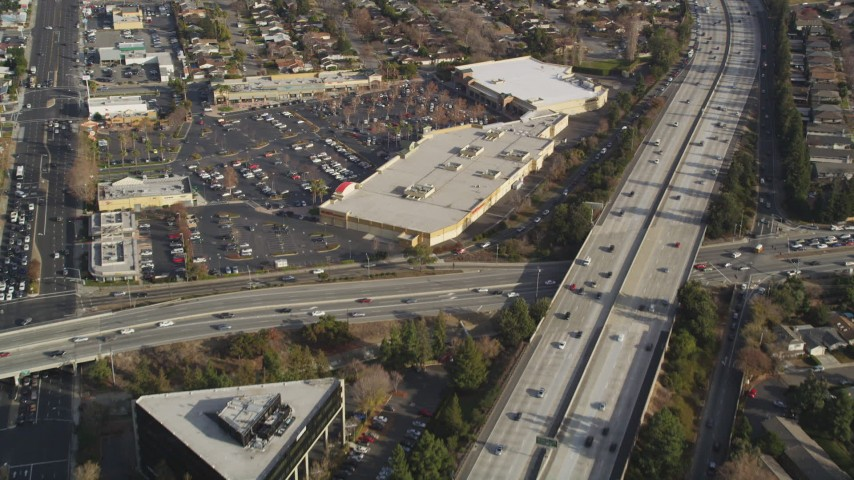 5K Aerial Video Reverse view of neighborhoods beside Interstate 280, reveal shopping center, San Jose, California Aerial Stock Footage | DCSF09_012