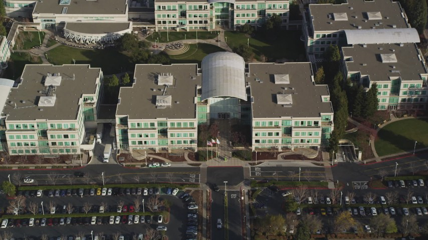 5K Aerial Video Fly over parking lots and reveal Apple Headquarters, tilt to bird's eye view, Cupertino, California Aerial Stock Footage | DCSF09_016