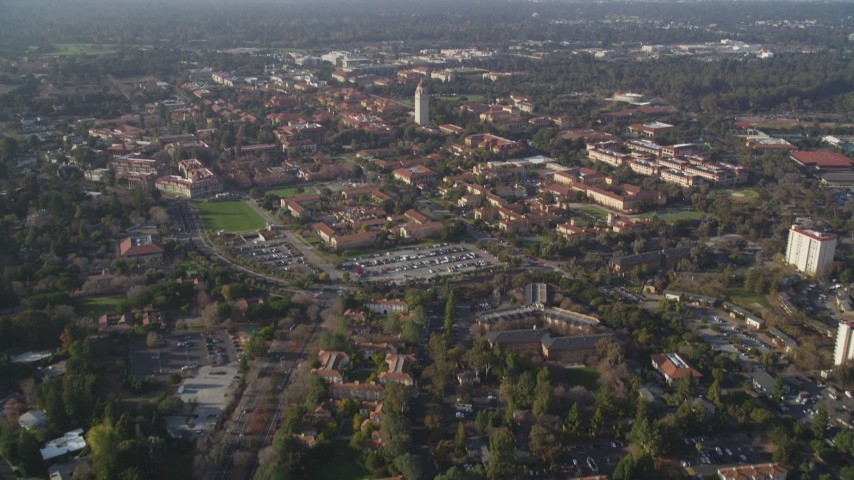 5K Aerial Video Tilt from apartment buildings to reveal and approach Hoover Tower and Stanford University, Stanford, California Aerial Stock Footage | DCSF09_018
