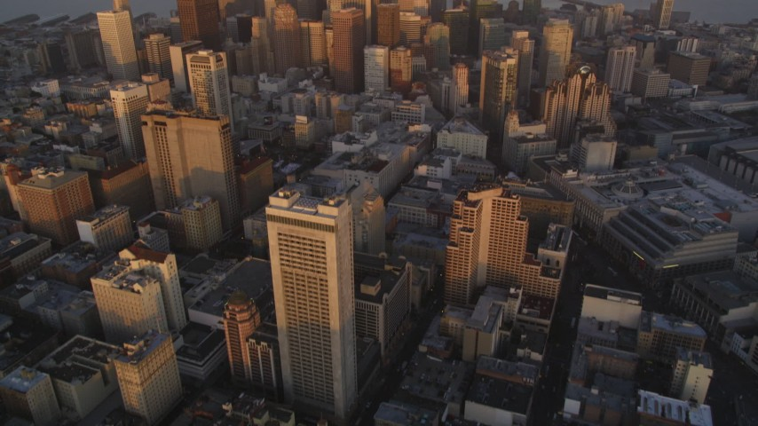 5K Aerial Video Tilt from downtown buildings to reveal and approach skyscrapers, Downtown San Francisco, California, twilight Aerial Stock Footage | DCSF10_005