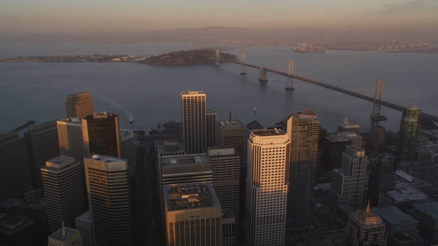 5K Aerial Video Fly over downtown to approach the Bay Bridge, San Francisco, California, twilight Aerial Stock Footage | DCSF10_007