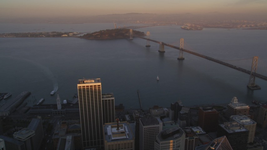 5K Aerial Video Approach the Bay Bridge from Downtown San Francisco, California, twilight Aerial Stock Footage | DCSF10_008