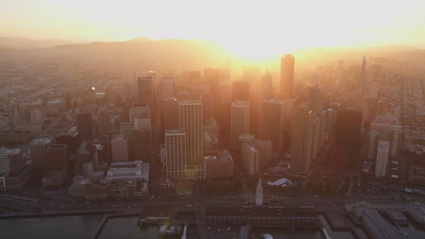 5K Aerial Video Downtown skyscrapers and the Ferry Building, San Francisco, California, sunset Aerial Stock Footage | DCSF10_009
