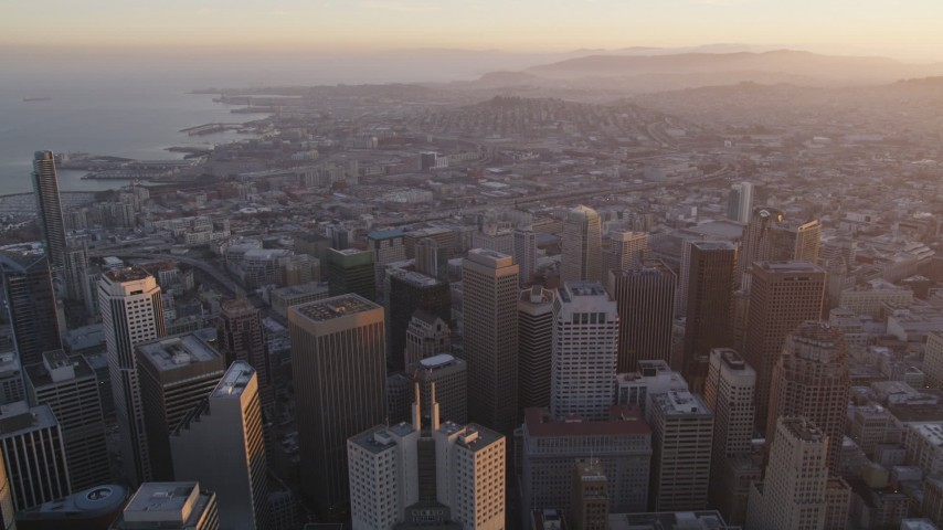 5K Aerial Video Tilt from city streets and fly over Financial District toward South of Market, San Francisco, California, twilight Aerial Stock Footage | DCSF10_011