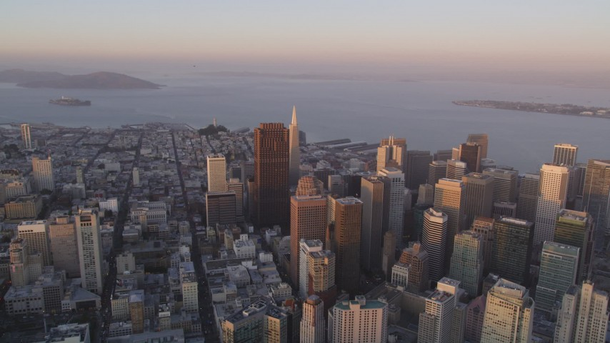5K Aerial Video Pan across Downtown San Francisco, California, sunset, with views of San Francisco Bay and Bay Bridge Aerial Stock Footage | DCSF10_012