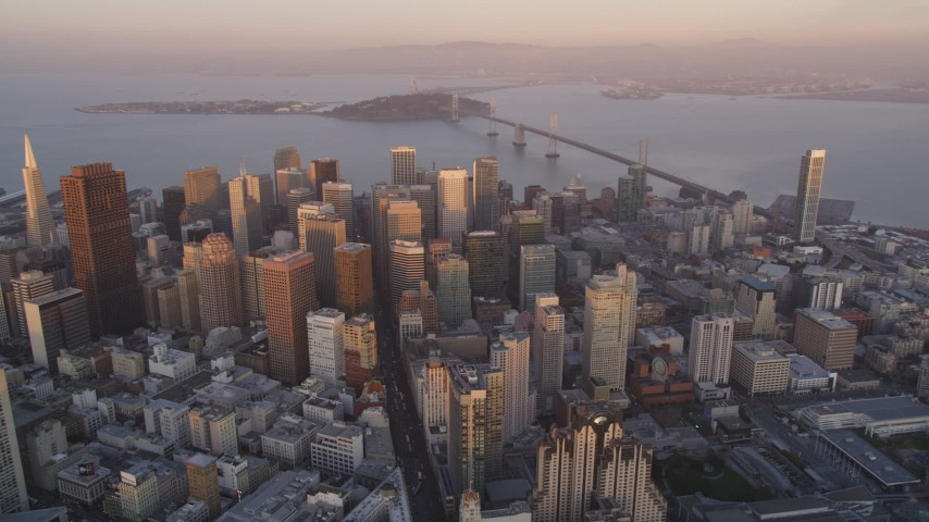 5K Aerial Video Reverse view of Downtown San Francisco, California, sunset, pan across cityscape Aerial Stock Footage | DCSF10_013