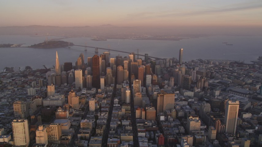 5K Aerial Video Reverse view of Downtown San Francisco and San Francisco Bay, California, twilight Aerial Stock Footage | DCSF10_014