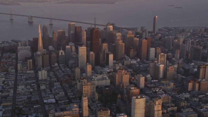5K Aerial Video Flyby Downtown San Francisco, California, twilight, Bay Bridge in the background Aerial Stock Footage | DCSF10_015