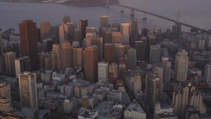 5K Aerial Video Approach and tilt to skyscrapers in Downtown San Francisco, California, sunset Aerial Stock Footage | DCSF10_018