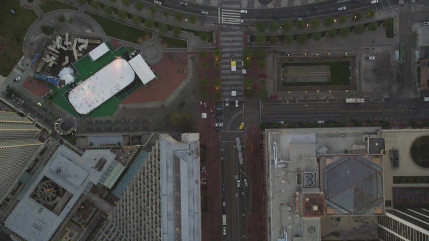 5K Aerial Video Bird's eye view of Market Street, reveal Justin Herman Plaza and Ferry Buildings, Downtown San Francisco, California, sunset Aerial Stock Footage | DCSF10_020