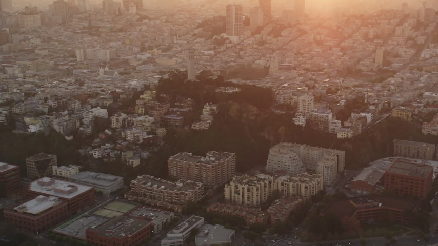 5K Aerial Video Flying by Coit Tower and North Beach apartment buildings, San Francisco, California, sunset Aerial Stock Footage | DCSF10_021