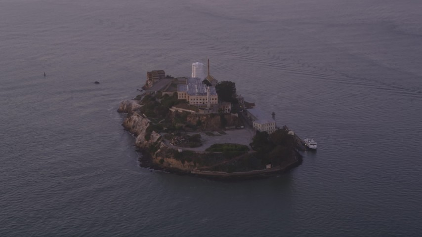 Approaching Alcatraz, San Francisco, California, sunset Aerial Stock Footage | DCSF10_022
