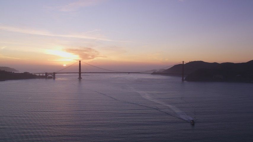 5K Aerial Video Setting sun behind the Golden Gate Bridge, San Francisco, California, sunset Aerial Stock Footage DCSF10_025