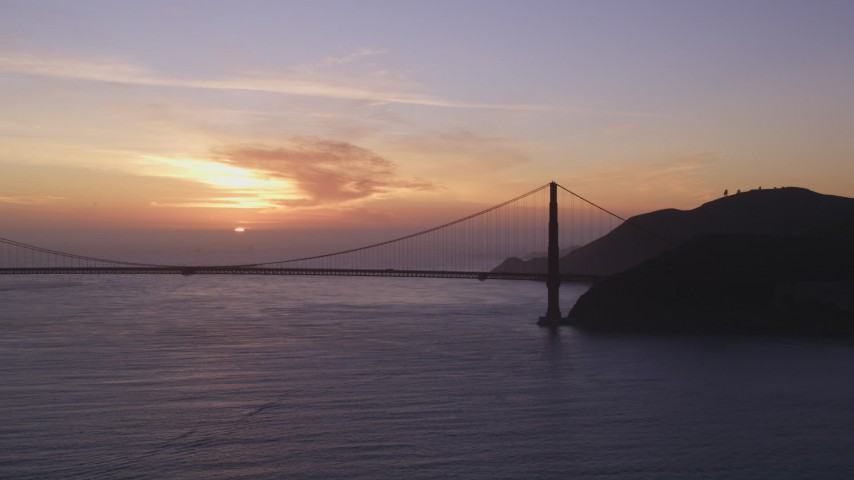 5K Aerial Video Golden Gate Bridge with setting sun in the distance, San Francisco, California, sunset Aerial Stock Footage | DCSF10_026