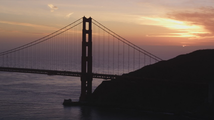 5K Aerial Video Pan across the north side of the Golden Gate Bridge, San Francisco, California, sunset Aerial Stock Footage | DCSF10_027