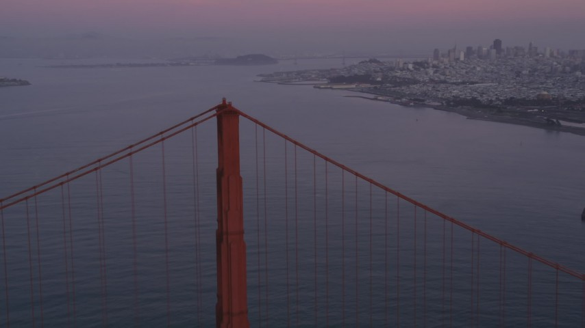 5K Aerial Video Flyby Golden Gate Bridge and pan to mid span, San Francisco, California, twilight Aerial Stock Footage | DCSF10_029