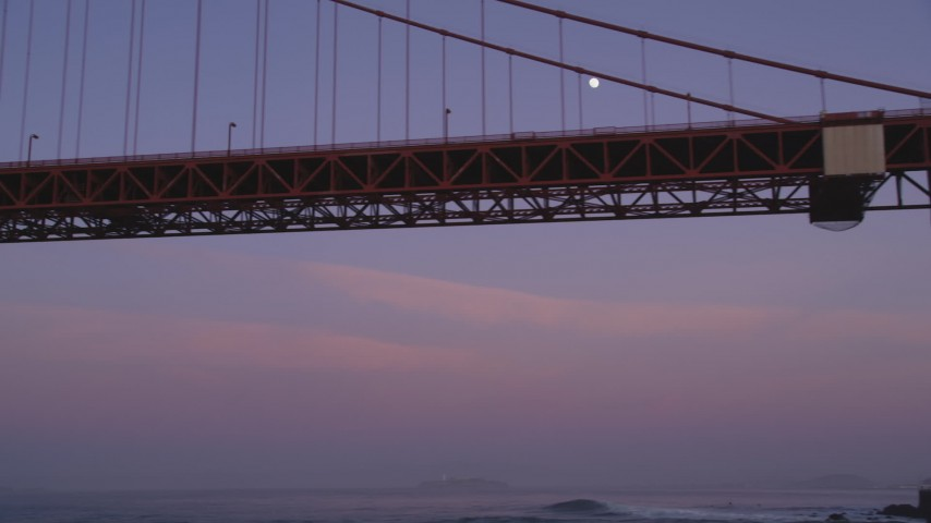 5K Aerial Video Fly low and look up at the moon and Golden Gate Bridge, San Francisco, California, twilight Aerial Stock Footage | DCSF10_033