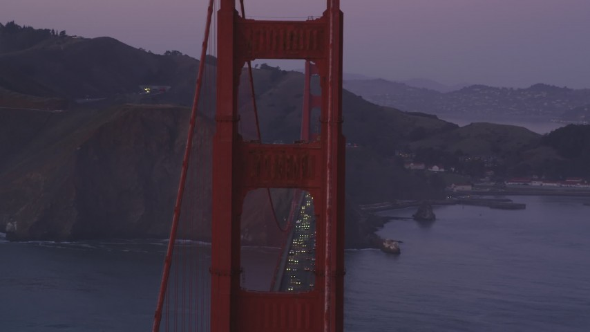 5K Aerial Video Flyby heavy traffic on the Golden Gate Bridge, San Francisco, California, twilight Aerial Stock Footage | DCSF10_037