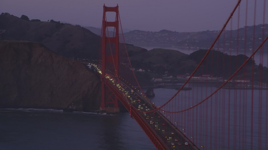 5K Aerial Video Flyby heavy traffic on the Golden Gate Bridge, San Francisco Bay, San Francisco, California, twilight Aerial Stock Footage | DCSF10_038