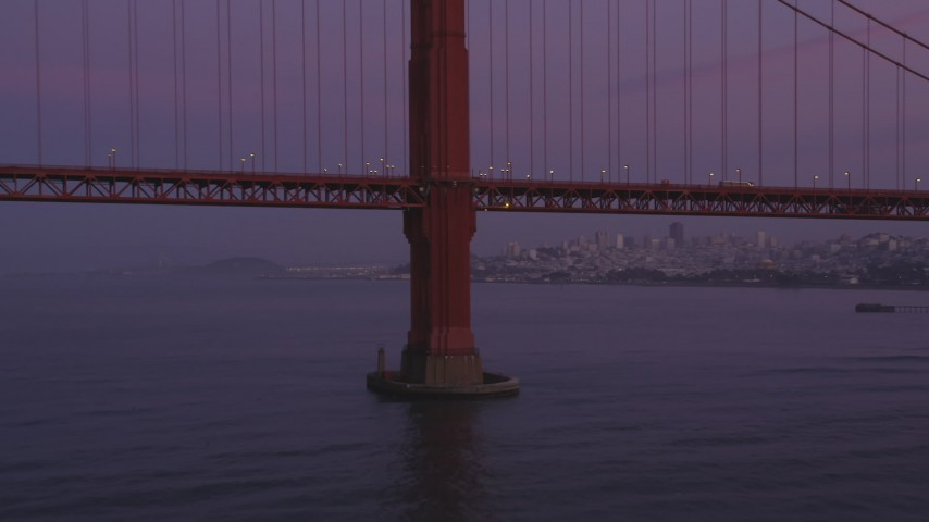 5K Aerial Video Flyby the base of a tower of the Golden Gate Bridge, San Francisco, California, twilight Aerial Stock Footage | DCSF10_040