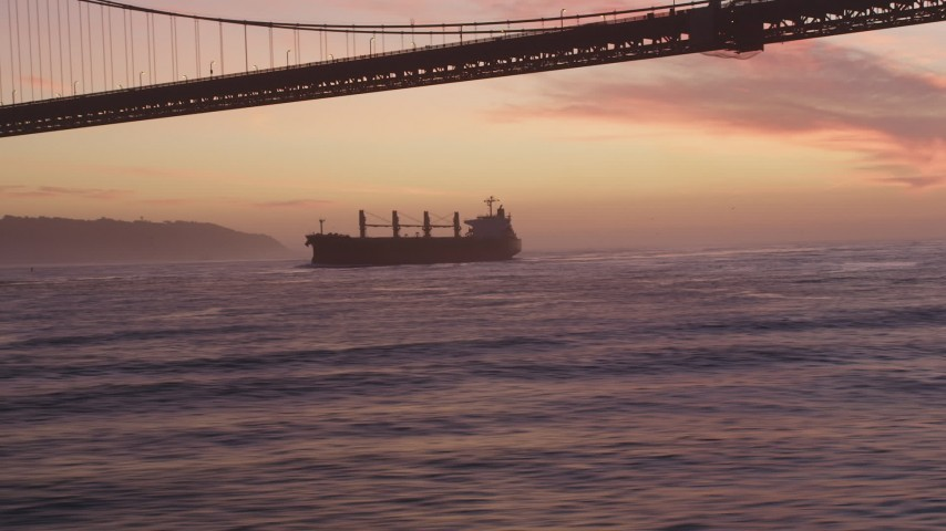 5K Aerial Video Track oil Tanker approaching Golden Gate Bridge, San Francisco, California, twilight Aerial Stock Footage | DCSF10_043