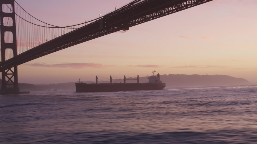 5K Aerial Video Track oil tanker sailing under the Golden Gate Bridge, San Francisco, California, twilight Aerial Stock Footage | DCSF10_044