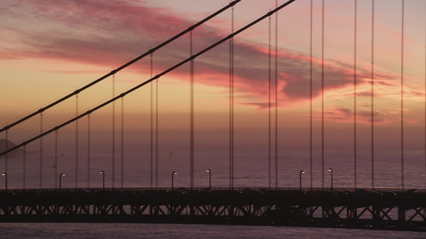 5K Aerial Video Tracking cars crossing the Golden Gate Bridge, San Francisco, California, twilight Aerial Stock Footage | DCSF10_048
