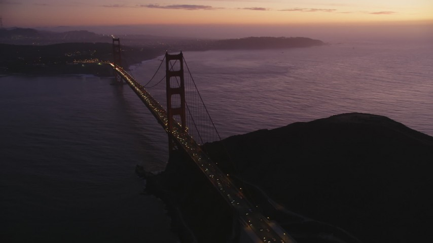 5K Aerial Video Flyby heavy traffic crossing the Golden Gate Bridge, San Francisco, California, twilight Aerial Stock Footage | DCSF10_050