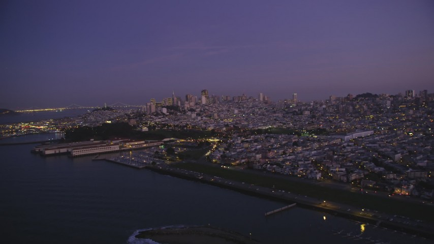 5K Aerial Video Flyby marina and Fort Mason, downtown skyline in the background, San Francisco, California, twilight Aerial Stock Footage | DCSF10_054