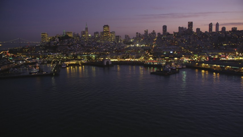 5K Aerial Video Flyby Fisherman's Wharf and downtown skyline, reveal Pier 39, North Beach, San Francisco, California, twilight Aerial Stock Footage | DCSF10_056
