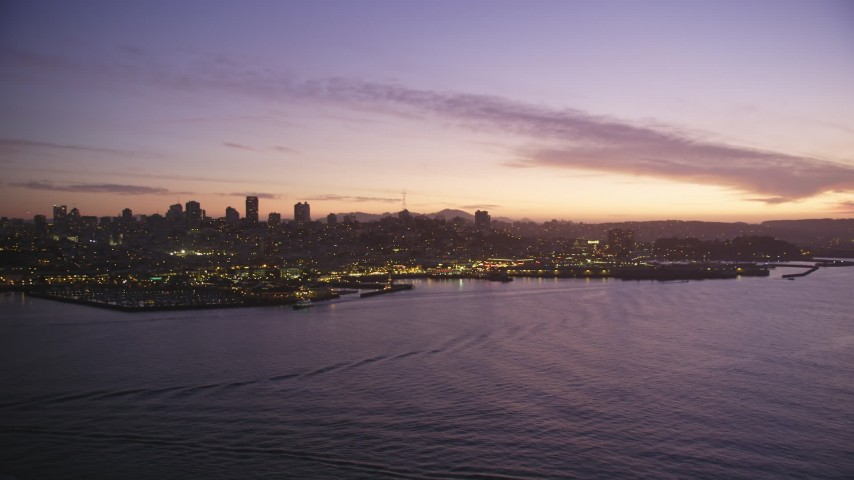 5K Aerial Video of A view of Downtown San Francisco skyline and Fisherman's Wharf, California, twilight Aerial Stock Footage | DCSF10_057