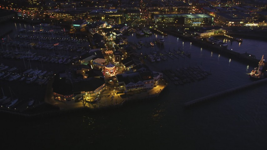 5K Aerial Video Tilt to a bird's eye view of Pier 39, decorated for Christmas, San Francisco, California, night  Aerial Stock Footage   DCSF10_059