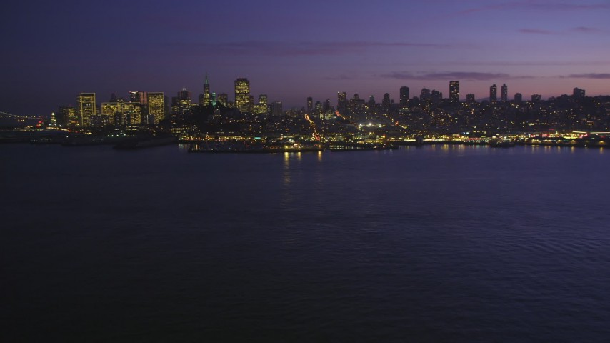 5K Aerial Video Low altitude approach to Pier 39 and skyline of Downtown San Francisco, California, twilight Aerial Stock Footage | DCSF10_060
