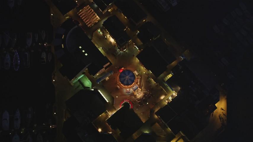 5K Aerial Video Bird's eye view of shops at Pier 39, San Francisco, California, night Aerial Stock Footage | DCSF10_061