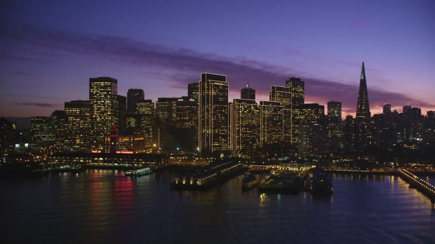 5K Aerial Video Ferry Building and the skyline of Downtown San Francisco, California, twilight Aerial Stock Footage DCSF10_062 | Axiom Images